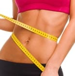 sport, fitness and diet concept – close up of trained belly with