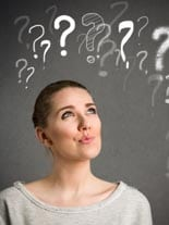 Young woman makes a face and thinking with question marks over h