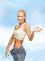 fitness, diet and healthcare concept – sporty woman showing big